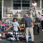 Yard sales popped up like dandelions across Bedford on Saturday.