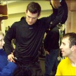 Logan in the Boston Bruins dressing room in March. Zheno Chara (right) climbed Mount Kilimanjaro to raise funds for improving lives in Africa and Andrew Ference (left) is active in supporting African communities.