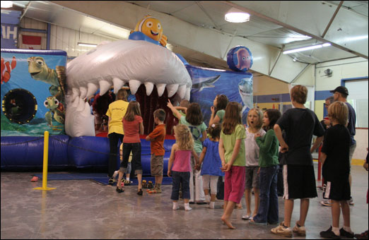 Kids wait to enter a bouncy shark during a charity event in support of Dyrick McDermott's family at the LeBrun Centre on Saturday. The Bedford resident died unexpectedly on April 17, 2009, leaving behind a wife and two young children.