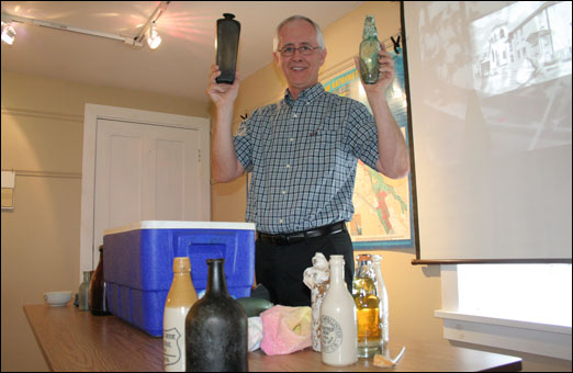Author, historian, scuba diver Bob Chaulk shows some of the artifacts he has found in the Halifax Harbour.