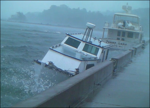 Boats seeking refuge were getting knocked around as Hurricane Bill arrived at the Bedford Waterfront on Sunday morning.