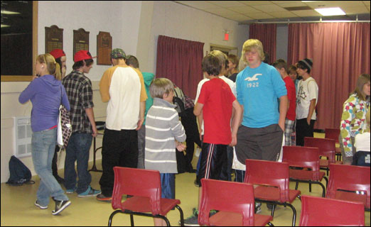 A group of youths eagerly lines up to sign their names on a sheet at the preliminary meeting to determine whether Bedford youths want a bike/skate park in town.