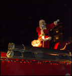 Santa waves to a crowd of kids, big and small, during the 2007 Light Up Bedford Parade.
