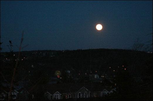 A full moon lights up Bedford, Nova Scotia on December 2, 2009.