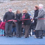 Bedford South School principal Derek Carter (left), co-chairs of the playground committee Jacalyn Leeco and Lori Shea, HRM Park Planner Therese Delorme and Bedford Councillor Tim Outhit get ready to cut the ribbon.