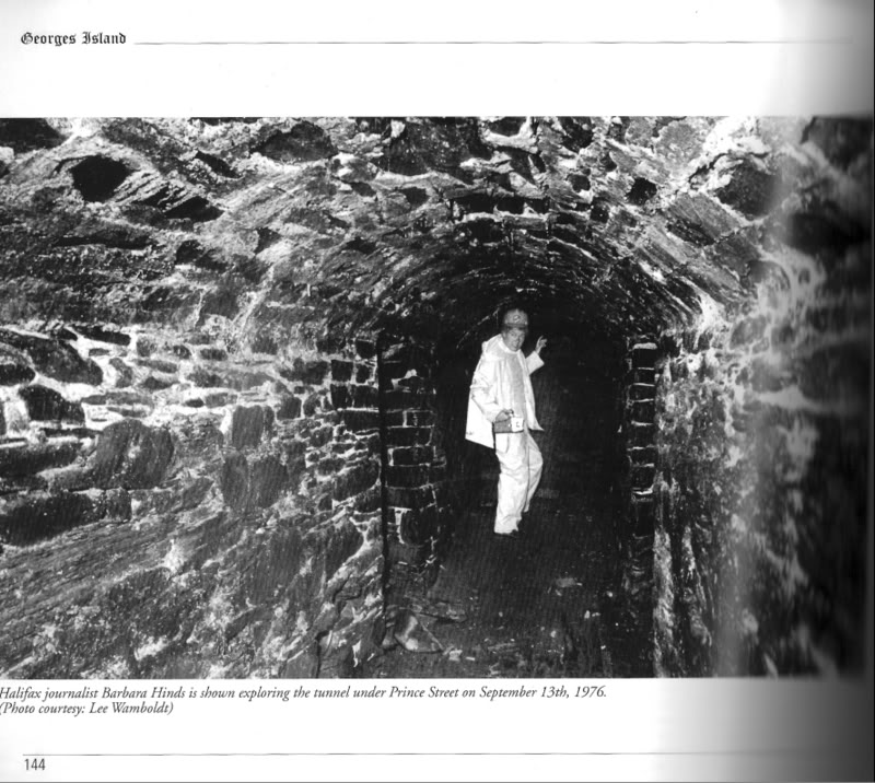 "Caption reads: ""Halifax journalist Barbara Hinds is shown exploring the tunnel under Prince Street on September 13, 1976. Photo courtesy: Lee Wamboldt"""