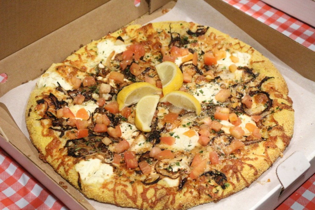 Salvatore's Bianco in Stephano: garlic infused oil, cornmeal edged crust, mozzarella, onions, ricotta, parsley, parmesan, romano cheese, fresh tomatoes, herbs & a squeeze of lemon.