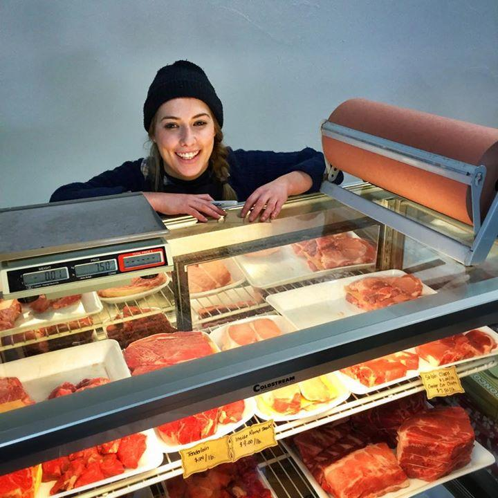 Brianna Hagell offers local meat at the Alderney Market. (Photo by Doug Townsend)