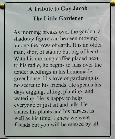 A tribute to Guy is posted on the door of the community garden shed.