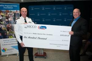 Mickey MacDonald presents cheque to Chief JM Blais.